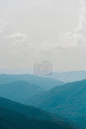 Photo for Tranquil mountain valley against sky white white clouds - Royalty Free Image