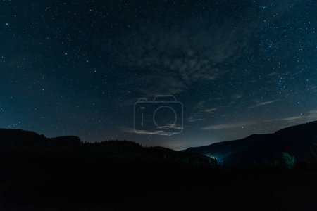Photo for Milky way rise in dark forest at night - Royalty Free Image