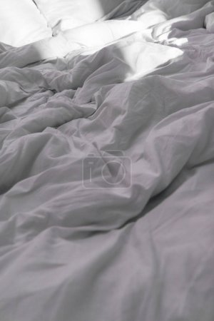 Photo for Selective focus of bed with white blanket in daytime - Royalty Free Image