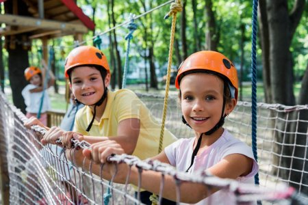 Photo for Selective focus of happy kids in adventure park - Royalty Free Image
