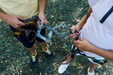 Photo pour Overhead view of kids with safety equipment standing outside - image libre de droit