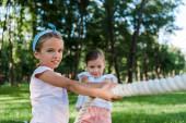 """Постер, картина, фотообои """"happy and cute kids competing in tug of war outside"""""""