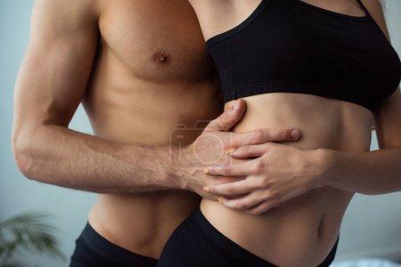 Photo pour Cropped view of seductive man touching sexy woman - image libre de droit