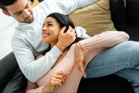 Photo for African american woman and handsome man smiling and hugging in apartment - Royalty Free Image