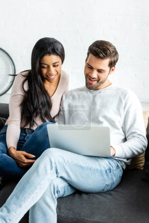 Photo for Smiling african american woman and handsome man looking at laptop - Royalty Free Image