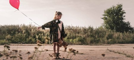 Photo for Panoramic shot of cute child with gas mask holding balloon, post apocalyptic concept - Royalty Free Image