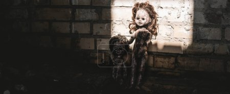 Photo for Panoramic shot of old and scary baby dolls near brick wall, post apocalyptic concept - Royalty Free Image
