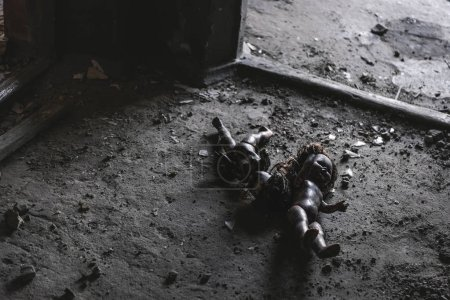 Photo for Abandoned and scary baby dolls on ground, post apocalyptic concept - Royalty Free Image