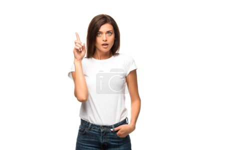 Photo pour Beautiful shocked woman in white t-shirt pointing up, isolated on white - image libre de droit