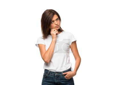 Photo for Attractive pensive woman in white t-shirt, isolated on white - Royalty Free Image