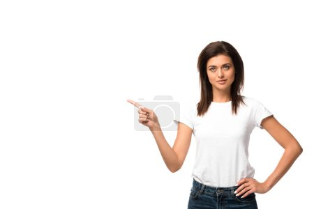beautiful woman in white t-shirt pointing at something, isolated on white