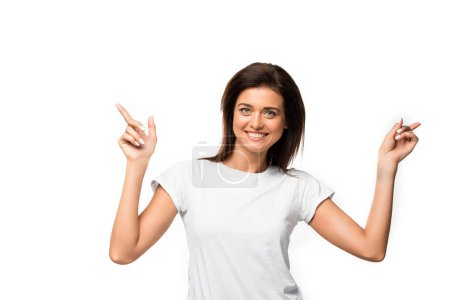 Photo for Beautiful happy woman in white t-shirt pointing isolated on white - Royalty Free Image