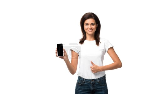 Photo for Beautiful young woman showing thumb up and smartphone with blank screen, isolated on white - Royalty Free Image