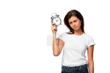 beautiful sad woman holding alarm clock, isolated on white