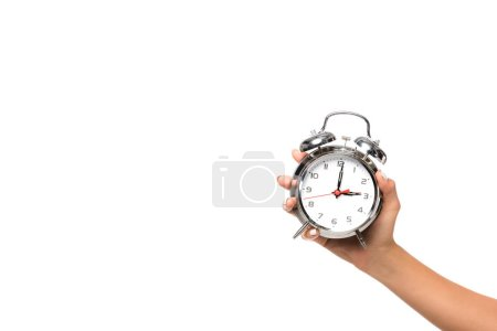 Photo for Partial view of woman holding alarm clock, isolated on white - Royalty Free Image