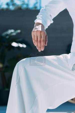 Photo for Cropped view of woman in white suit posing outside - Royalty Free Image