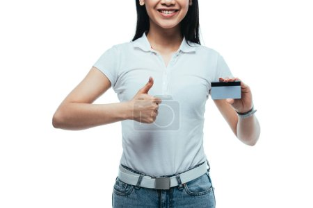 Photo for Cropped view of happy attractive asian girl holding credit card and showing thumb up isolated on white - Royalty Free Image
