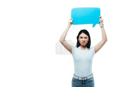 upset asian girl holding blue blank speech bubble isolated on white