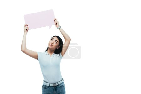 Photo for Attractive asian girl looking at pink blank speech bubble isolated on white - Royalty Free Image