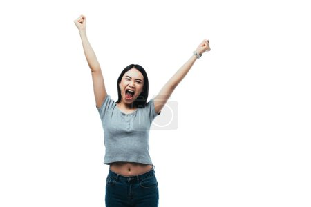 Photo for Happy asian girl showing yeah gesture with open mouth isolated on white - Royalty Free Image