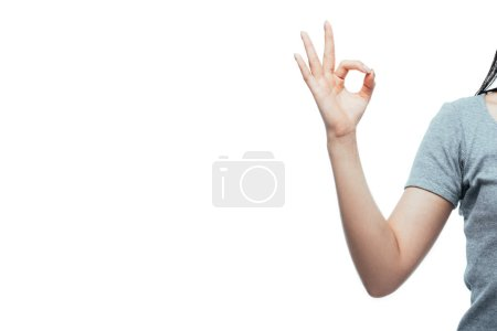 cropped view of girl showing ok sign isolated on white