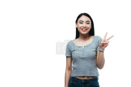 Photo pour Heureux asiatique fille montrant paix signe isolé sur blanc - image libre de droit
