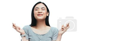 Photo for Asian girl with closed eyes and crossed fingers isolated on white, panoramic shot - Royalty Free Image