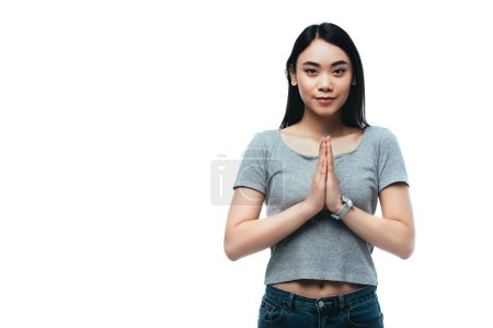Photo for Smiling asian girl with praying hands isolated on white - Royalty Free Image