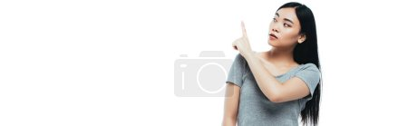 Photo for Asian girl pointing with finger aside isolated on white, panoramic shot - Royalty Free Image