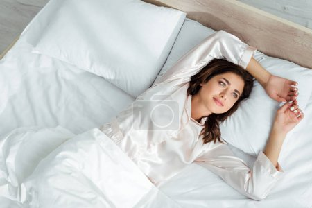 Photo for High angle view of attractive woman lying in bed at morning - Royalty Free Image