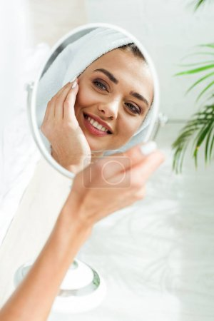 Photo for Reflection attractive and smiling woman looking at mirror at morning - Royalty Free Image