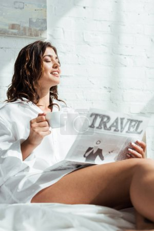 Photo for Attractive woman in white shirt holding cup of coffee and reading newspaper travel at morning - Royalty Free Image