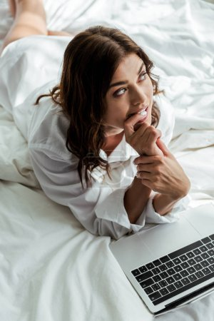 high angle view of pensive woman looking away at morning