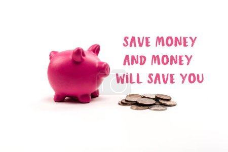 Photo pour Pink piggy bank near coins and save money and money will save you lettering on white background - image libre de droit