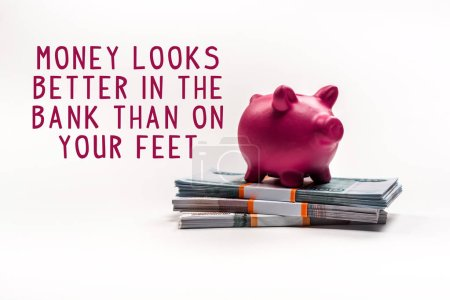 Photo pour Pink piggy bank on stack of russian rubles on white background with money looks better in the bank than on your feet - image libre de droit