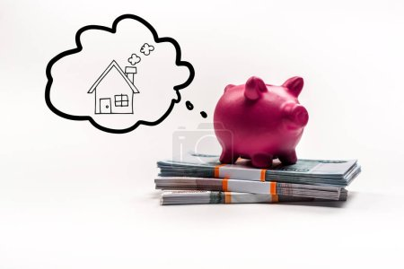 Photo pour Pink piggy bank on stack of russian rubles on white background with house in thought bubble illustration - image libre de droit
