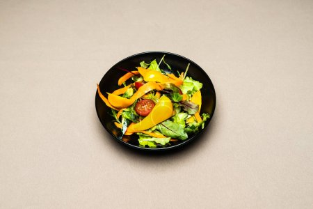 Photo for Salad in plate with fork and knife on table - Royalty Free Image