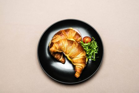 Photo for Top view of croissants in black plate on table for breakfast - Royalty Free Image