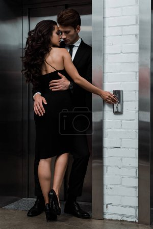 Photo for Beautiful sensual couple hugging and flirting near lift - Royalty Free Image