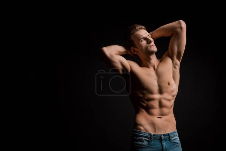 Photo for Muscular shirtless man posing isolated on black - Royalty Free Image