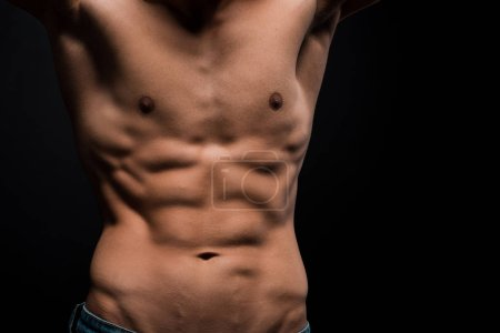 Photo for Cropped view of shirtless male torso isolated on black - Royalty Free Image
