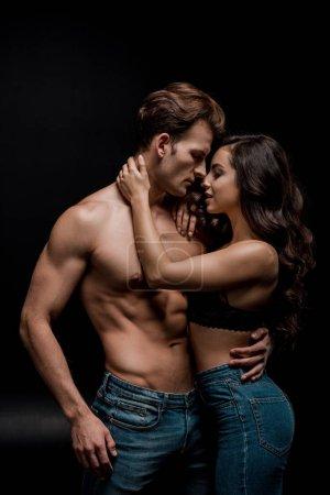 Photo for Beautiful seductive couple hugging, isolated on black - Royalty Free Image