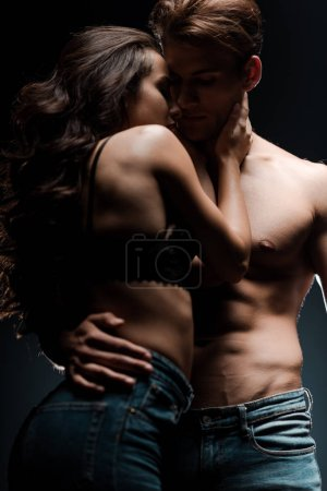 Photo for Beautiful sexy couple hugging in black room with smoke - Royalty Free Image