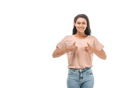 happy african american woman looking at camera and showing thumbs up isolated on white