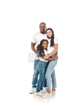 Photo for Happy african american father, mother and daughter hugging and smiling at camera on white background - Royalty Free Image