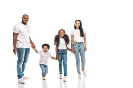 Photo pour Heureux afro-américains parents tenant la main avec fille et fils tout en se tenant sur fond blanc - image libre de droit