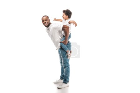 Photo for Cheerful african american man piggybacking adorable son and smiling at camera on white background - Royalty Free Image