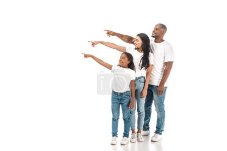 african american mother, father and daughter pointing with fingers and looking away on white background