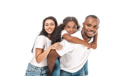 Photo for Happy african american man piggybacking daughter near smiling wife isolated on white - Royalty Free Image