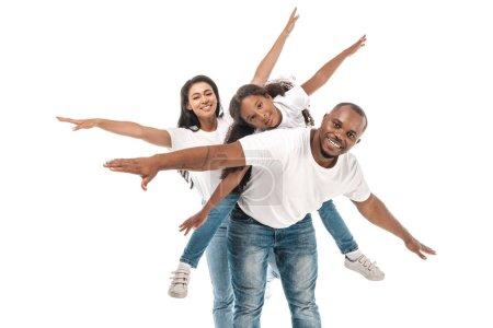 Foto de Alegre familia afriamericana imitando volar con las manos extendidas sobre fondo blanco. - Imagen libre de derechos
